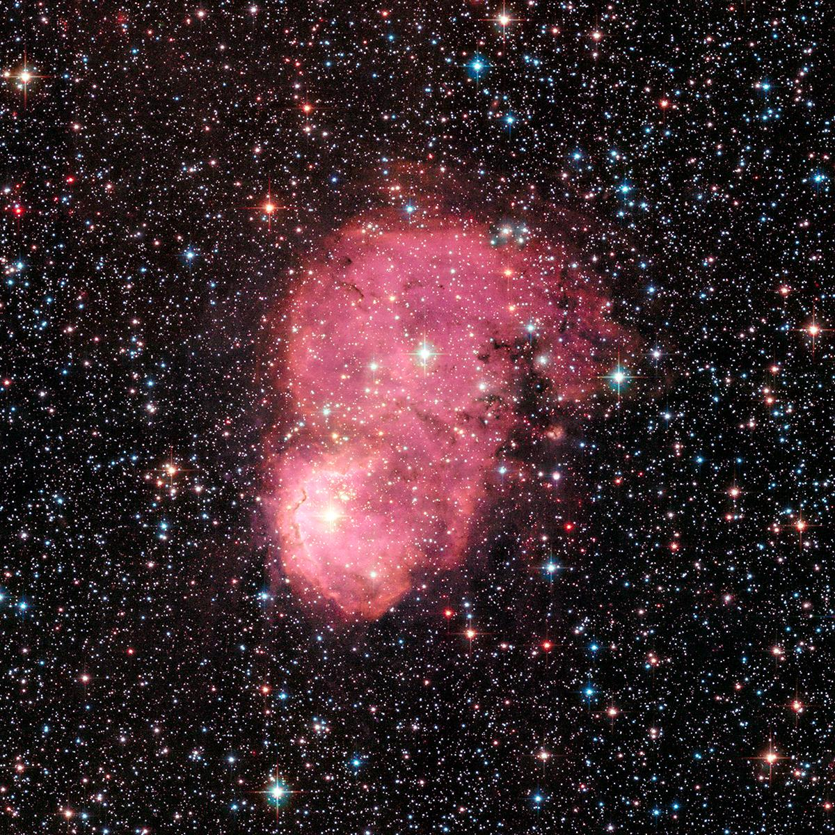 Hubble Space Telescope Photographs NGC 248 — A Pair Of Glowing Hydrogen Nebulae In The Small Magellanic Cloud