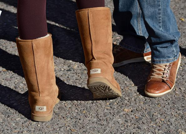 bceb62983d2d2 ... has sued several retailers for allegedly copying its Bailey's Button  boot design. A woman wears a pair of UGG boots in Santa Fe, New Mexico.