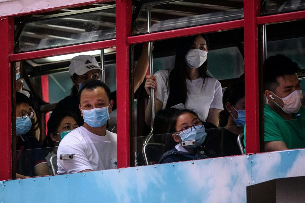 Hong Kong Reimposes Social Distancing As Virus Cases...