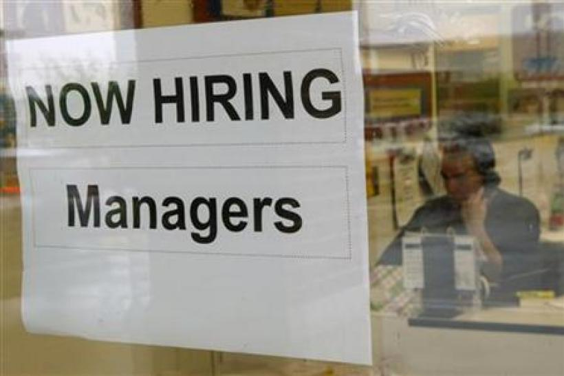 A hiring sign hangs in a window in Virginia