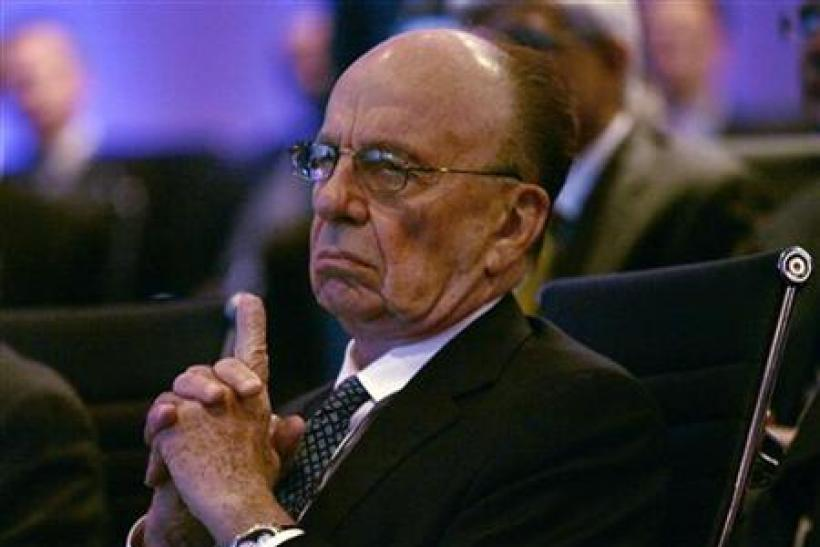 "News Corporation Chairman and CEO Rupert Murdoch listens to morning discussion session during the Wall Street Journal CEO Council on ""Rebuilding Global Prosperity"" in Washington"