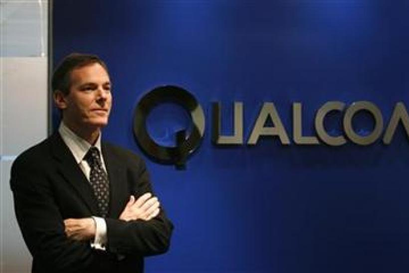 Qualcomm Chief Executive Paul Jacobs poses during his meeting with reporters in Hong Kong