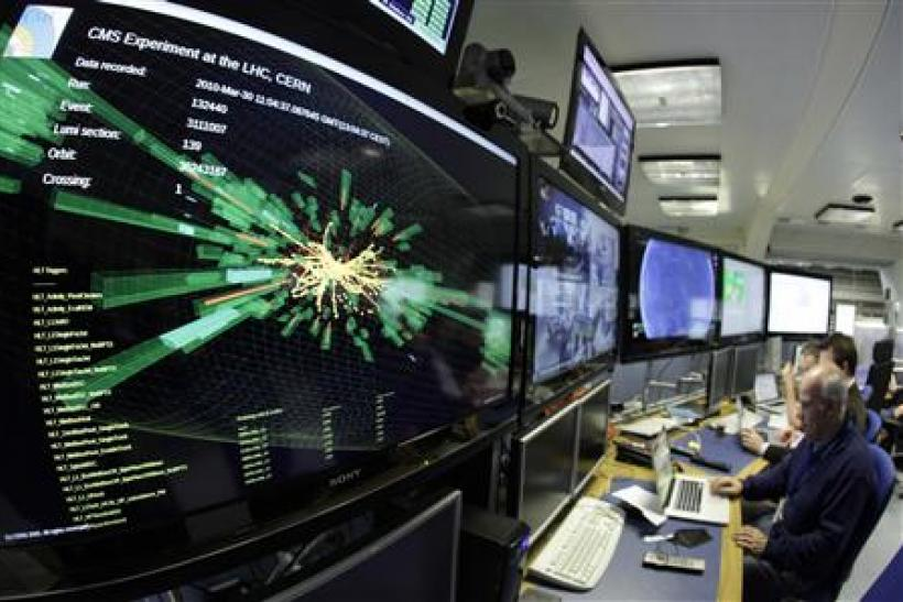 A graphic showing a collision at full power is pictured at the CMS experience control room of the LHC at the CERN in Meyrin