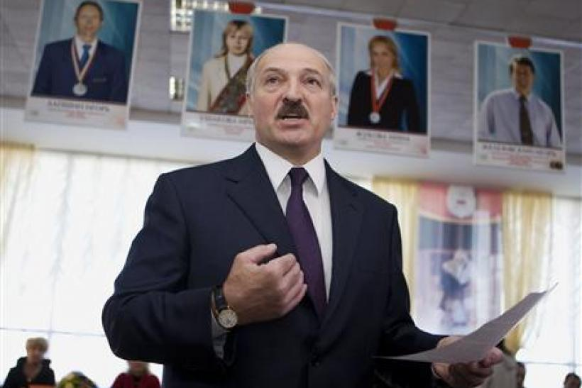 Belarussian President Alexander Lukashenko speaks to the media at a polling station during local election in Minsk