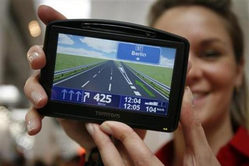 Model displays new TOMTOM Go navigation device during first public day at the CeBIT computer fair in Hanover