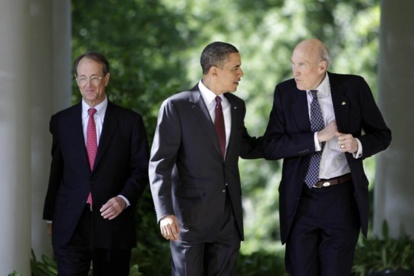 U.S. President Barack Obama speaks with former Republican Senate Whip Alan Simpson