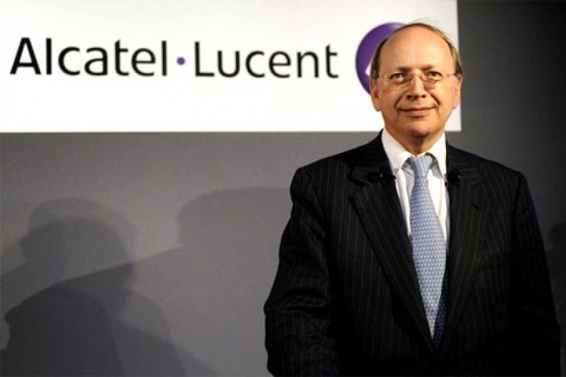 Alcatel-Lucent Chief Executive Ben Verwaayen poses for photographers