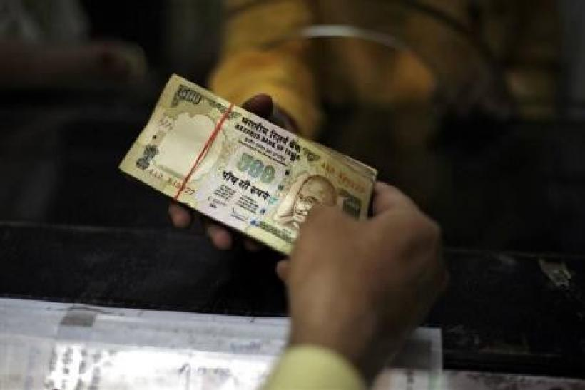 The rupee ended stronger on Monday as investors took comfort from the $1 trillion emergency rescue package aimed at preventing Greece's debt crisis from spreading through the euro zone.