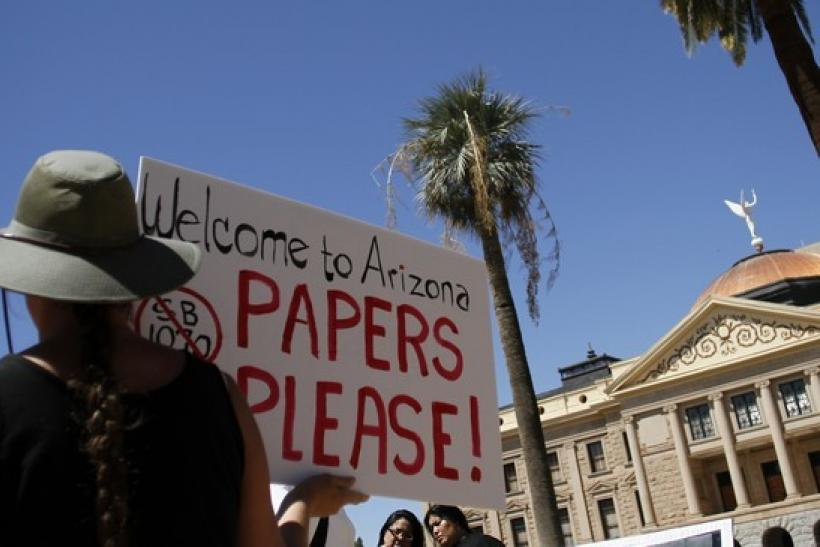 A demonstrator holds a sign during an immigration rally in Arizona
