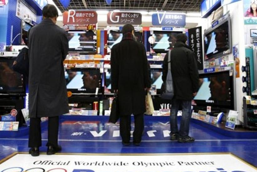 People look at Panasonic plasma televisions displayed at an electronics store in Tokyo January 8, 2010
