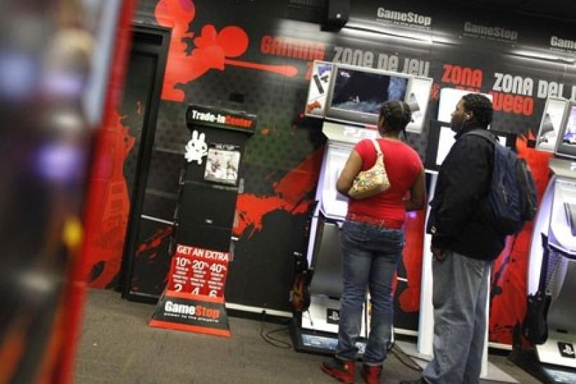 People play video games inside a GameStop retail store in New York March 18, 2010