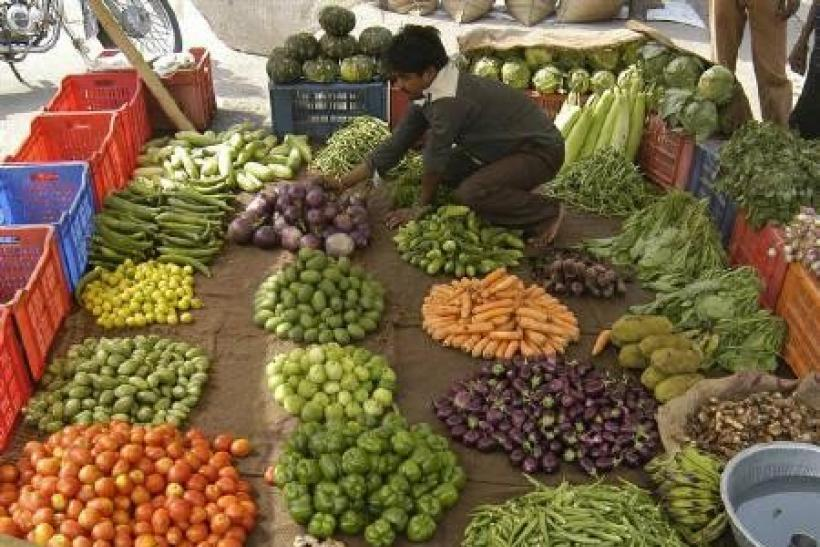 A vendor arranges vegetables at a market in Lucknow in this May 6, 2010 file photo.