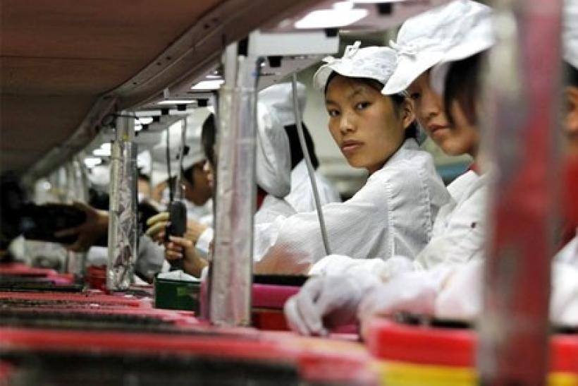 Workers are seen inside a Foxconn factory in the township of Longhua in the southern Guangdong province May 26, 2010
