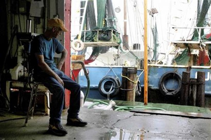 Twenty-Seven year shrimp farmer Robert Armand sits idle at Dean Blanchard Seafood in Grand Isle