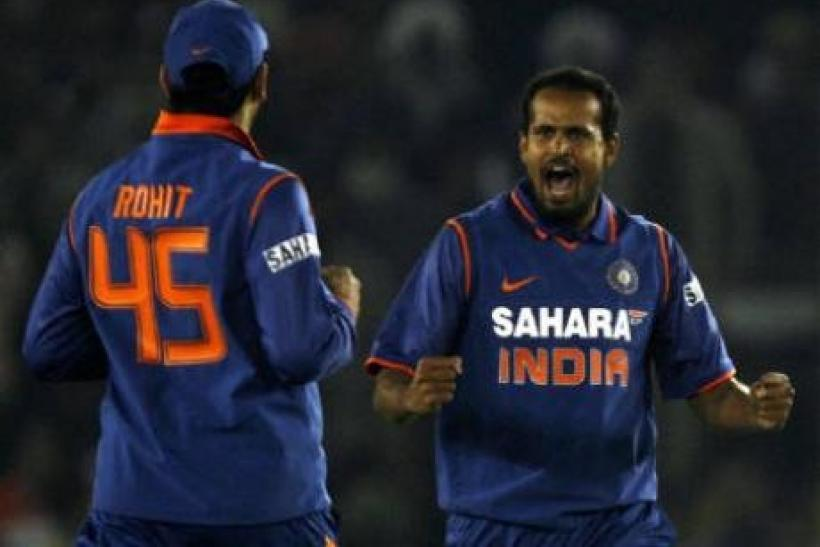 Yusuf Pathan (R) celebrates with teammate Rohit Sharma during a Twenty20 cricket match against Sri Lanka in Mohali in this December 12, 2009 file photo. The Board of Control for Cricket in India (BCCI) will not send a team to this year's Asian Games in Ch
