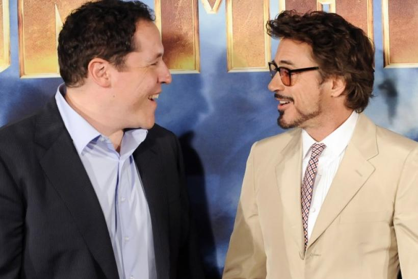 Director Jon Favreau and actor Robert Downey Jr talk while posing during a photocall for the movie Iron Man 2 in Los Angeles.
