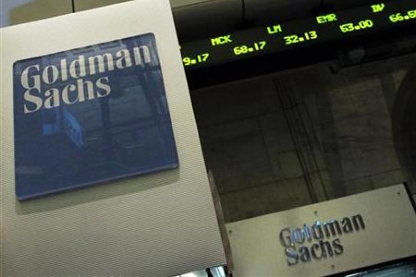 A Goldman Sachs sign is seen over a kiosk on the floor of the New York Stock Exchange