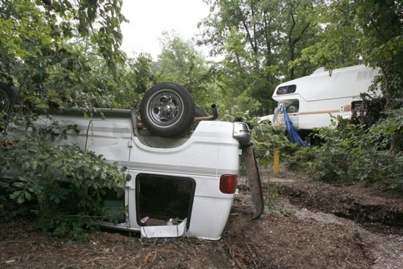 An over-turned van and a damaged vehicle are seen near the Little Missouri river bed at the Albert Pike recreation area near Caddo Gap, Arkansas June 12, 2010.