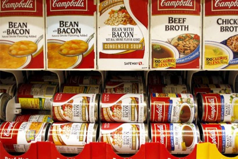 Cans of Campbell's Soup are stocked on a shelf at a grocery store in Phoenix