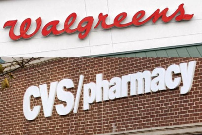 A combination photo showing the signs at a Walgreens store is seen in Golden, Colorado and (below) a CVS drugstore in Boston, Massachusetts