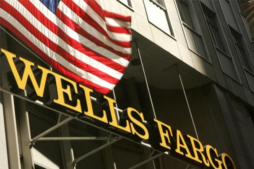 A US flag flies above Wells Fargo & Co headquarters in San Francisco