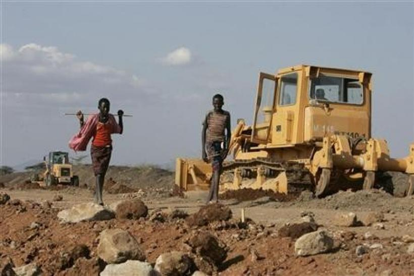 Turkana boys walk past a road construction project near Isiolo town