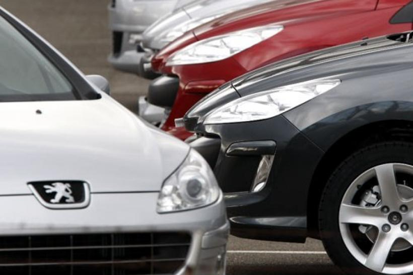 Cars are lined up on a parking lot of French car maker Peugeot in Markolsheim, France
