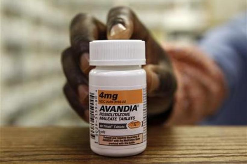 A pharmacist holds a bottle of Avandia in a store in Falls Church, Virginia