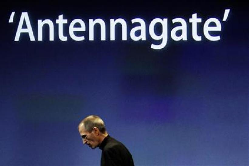 Apple CEO Jobs on stage during the 'antennagate' news conference