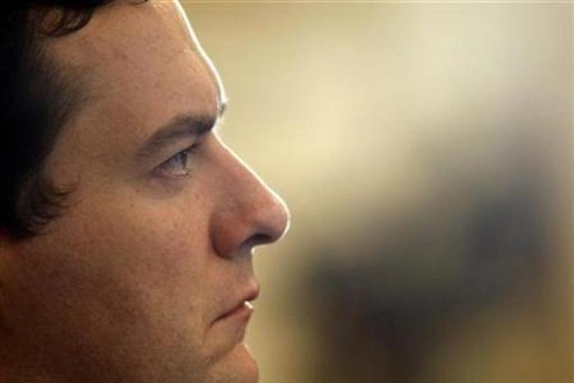 Chancellor George Osborne listens to David Cameron