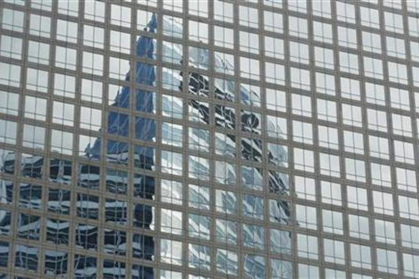 The Goldman Sachs headquarters building is reflected in the windows of a neighbouring building in New York