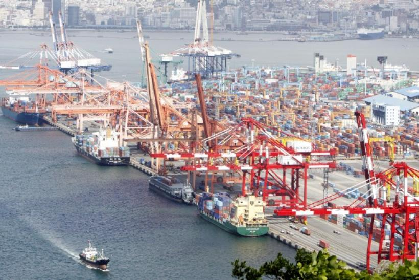 File photo shows container ships docking at a port in Busan