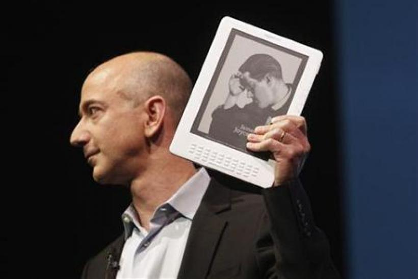Amazon.com founder and CEO Jeff Bezos holds the new Kindle DX electronic reader at a news conference where the device was introduced in New York
