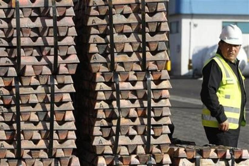 A security guard stands next to a shipment of copper ready to be delivered in Valparaiso city