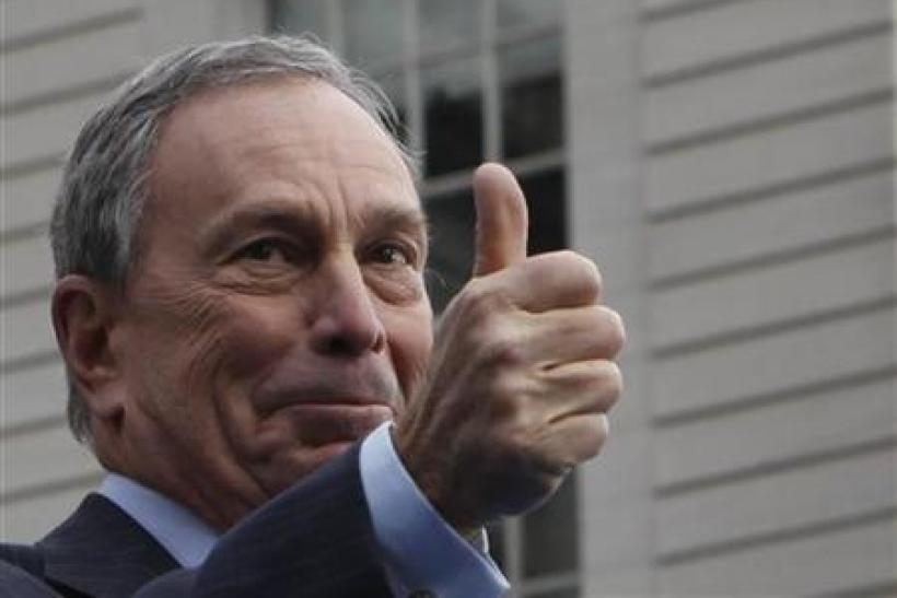 Mayor Bloomberg gestures to the crowd after taking the Oath of Office during his inauguration at New York's City Hall
