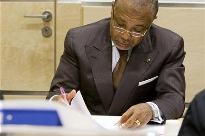 Former Liberian President Charles Taylor sits in the courtroom of the International Criminal Court (ICC)