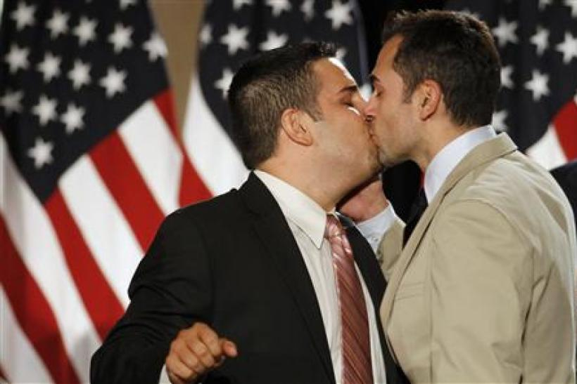 Jeff Zarrillo kisses his partner Paul Katami during a news conference in San Francisco following a decision by US District Judge Vaugh Walker that says Proposition 8 violates gays' and lesbians' rights of equality