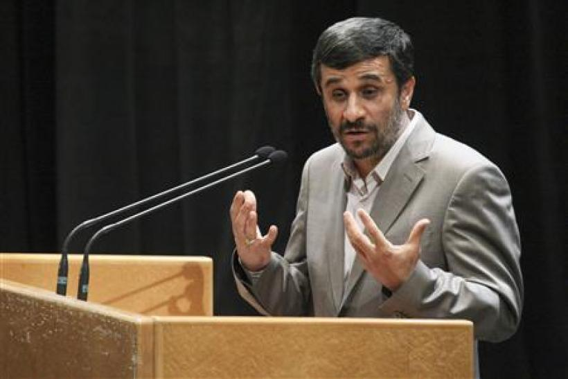 Iranian President Mahmoud Ahmadinejad gestures while speaking at a ceremony to mark the National Journalist Day in Tehran