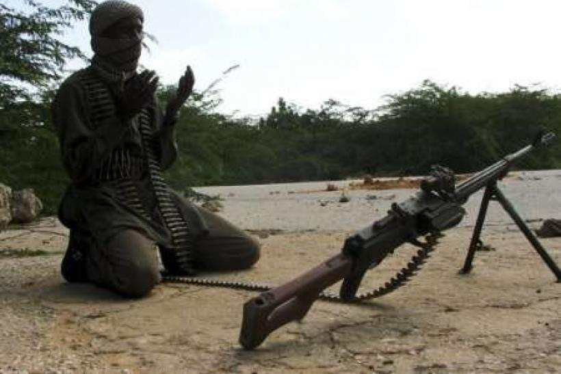 A hard-line Somali Islamist prays near a roadblock in southern Mogadishu September 18, 2009