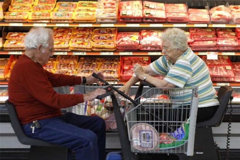 Customers shop for meat at Wal-Mart in Rogers, Arkansas