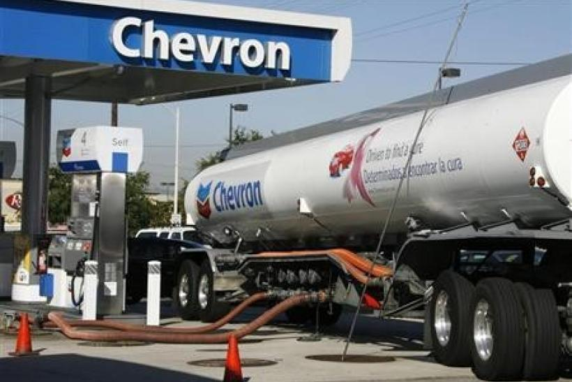 A Chevron tanker truck unloads gasoline into underground storage tanks in Burbank