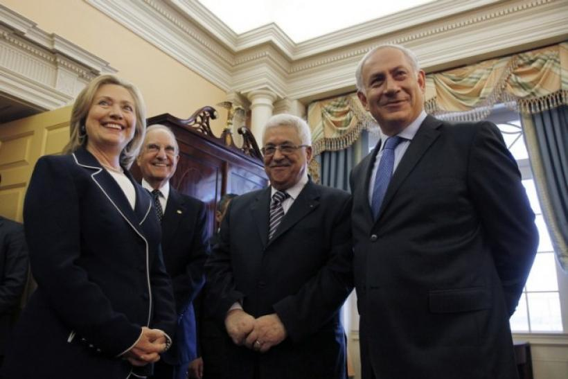 US Secretary of State Hillary Clinton (L) hosts Israel's Prime Minister Benjamin Netanyahu (R), President of the Palestinian Authority Mahmoud Abbas (2nd R) and George Mitchell, US Special Envoy for Middle East Peace (2nd L) in the Monroe Room
