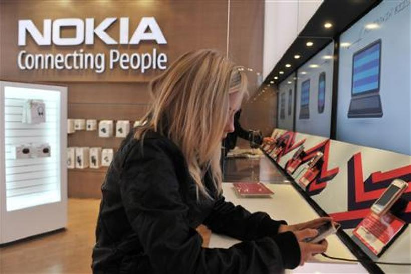 A girl tests out the new Nokia N8 mobile phone at the Nokia Flagship store in Helsinki