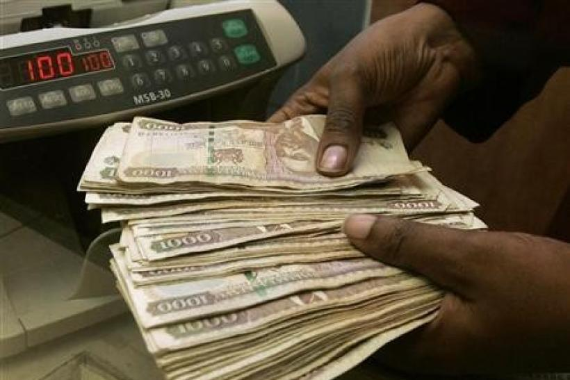 A currency dealer counts Kenya shillings at a money exchange counter in Nairobi