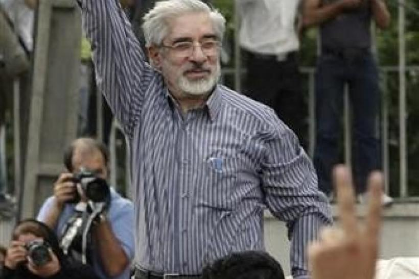 Defeated presidential candidate Mirhossein Mousavi attends a rally in support of him in Tehran