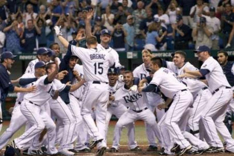 Tampa Bay Rays' Reid Brinac (15) jumps into the the arms of his teammates after hitting a walk off home run against the New York Yankees