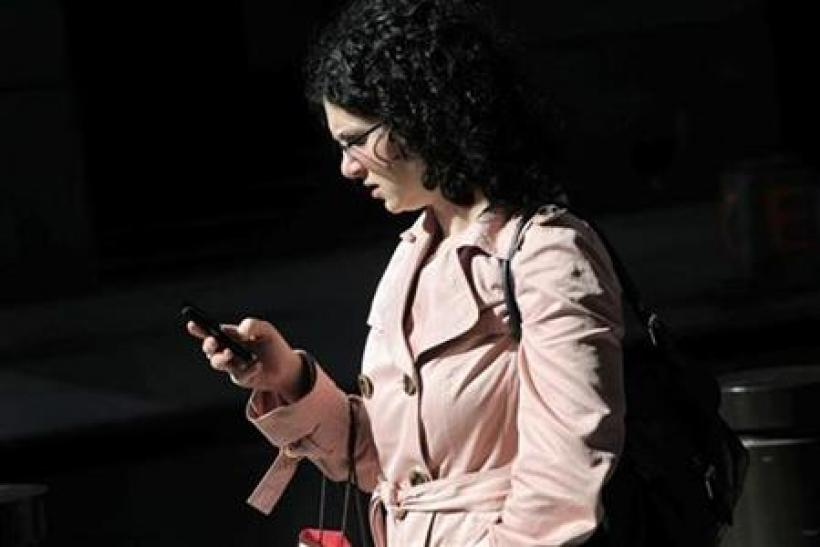 A woman uses a smartphone in New York