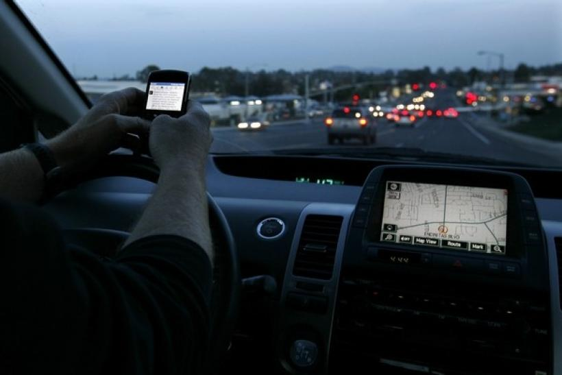 A driver uses his smart phone while in traffic in Encinitas, California December 10, 2009.