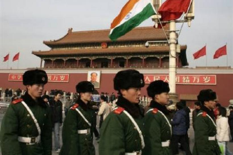 Chinese paramilitary policemen walk past an Indian flag in front of Tiananmen Gate in Beijing in this January 13, 2008 file photo. The emerging Asian giants of China and India may be locked in a battle for economic supremacy, but on the sporting front at