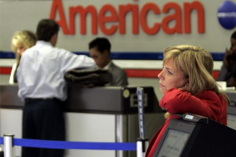 An American Airlines passenger service representative stands at Dallas/Fort Worth International Airport in Gapevine, Texas